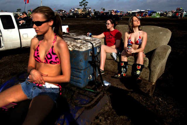 Megan McDaniel of New Smyrna Beach, Nikki Skaggs of Leachville, Arkansas, and Chelsea Johnson of Edgewater, Arkansas, take in the sights from a couch pulled by an ATV. (Photo by Gary Coronado/The Palm Beach Post)