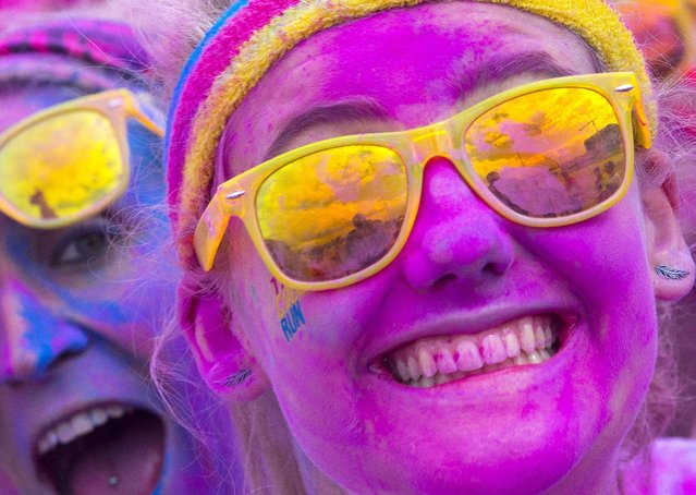 People take part in The Color Run in Brussels, Belgium September 6, 2015. (Photo by Yves Herman/Reuters)