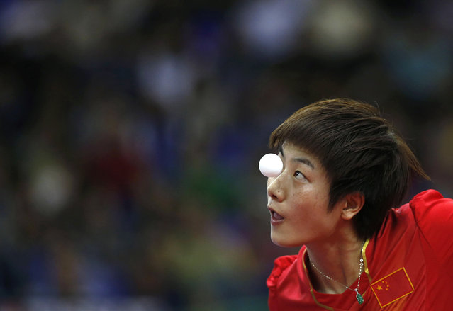 China's Ding Ning serves against Japan's Ai Fukuhara during their women's team gold medal table tennis match at Suwon Gymnasium during the 2014 Asian Games in Incheon September 30, 2014. (Photo by Kim Hong-Ji/Reuters)