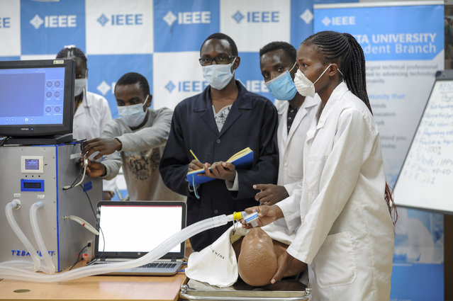 """In this Monday, April 13, 2020 file photo, medical students test a self-designed computer-controlled ventilator prototype at the Chandaria Business and Incubation Centre of Kenyatta University in Nairobi, Kenya. More than two dozen international aid organizations have told the U.S. government they are """"increasingly alarmed"""" that """"little to no U.S. humanitarian assistance has reached those on the front lines"""" of the coronavirus pandemic as the number of new cases picks up speed in some of the world's most fragile regions. (Photo by John Muchucha/AP Photo/File)"""