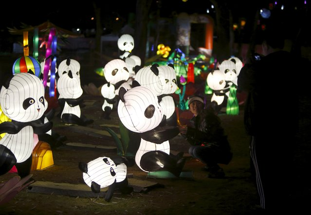 A visitor poses for a photo during the Dandenong Festival of Lights in the suburb of Dandenong in Melbourne, Australia, September 23, 2015. (Photo by Darrin Zammit Lupi/Reuters)
