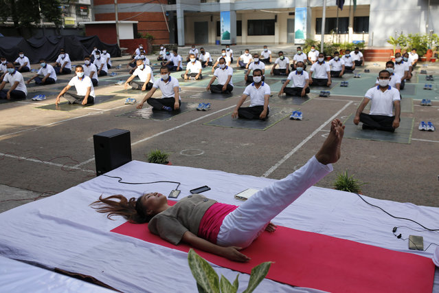 Member of the Bangladesh police attend a yoga session to boost the immune system during coronavirus (COVID- 19) pandemic in Dhaka on June 15, 2020. (Photo by MD Mehedi Hasan/ZUMA Wire/Rex Features/Shutterstock)