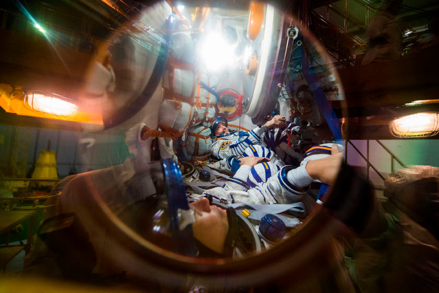 Members of the International Space Station (ISS) expedition 54/55, NASA astronaut Scott Tingle (back), Roscosmos cosmonaut Anton Shkaplerov (C) and Norishige Kanai of the Japan Aerospace Exploration Agency (JAXA) (front) take part in the preflight preparation at the Russian leased Kazakh Baikonur cosmodrome on December 05, 2017. The space crew is to take off to the International Space Station (ISS) aboard the Soyuz MS-07 on December 17, 2017 from the Baikonur Cosmodrome in Kazakhstan. (Photo by AFP Photo/Stringer)