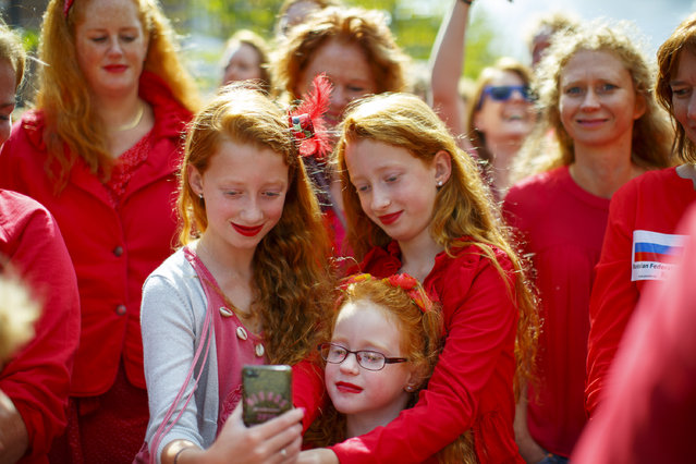 "A family pose for a picture as thousands of redheads fill a Dutch city Breda to celebrate International Redhead Day event in Breda, The Netherlands on Sunday, 4 September 2016. Every year natural redheads from more than 80 countries come together at ""Roodharigendag"" annual weekend long festival to celebrate their ginger genes. The event also holds the world record for the largest number of natural redheads being in one place. (Photo by Akmen/London News Pictures)"