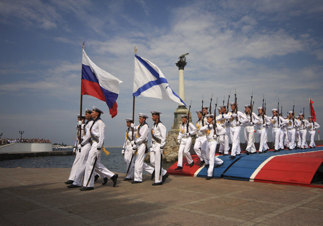 Russian sailors march during a naval parade rehearsal in the Crimean port of Sevastopol, July 25, 2014. (Photo by Reuters/Stringer)