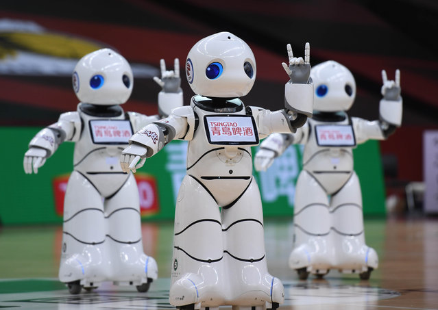 Robotic cheerleaders perform during a break of the round of 12 match between Zhejiang Lions and Fujian Sturgeons at the 2019-2020 Chinese Basketball Association (CBA) league playoffs in Qingdao, east China's Shandong Province, July 31, 2020. (Photo by Xinhua News Agency/Rex Features/Shutterstock)