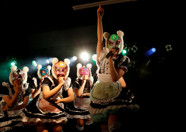 "Members of Japan's idol group ""Virtual Currency Girls"" wearing cryptocurrency-themed masks perform in their debut stage event in Tokyo, Japan, January 12, 2018. Each of the group's 8 members represents a cryptocurrency that is popular in the Japanese market. According to local publications, 18-year-old Naruse Rara who represents bitcoin cash (BCH) is the leader of the group. Representing bitcoin (BTC) is 16-year-old Hinano Shirahama. 22-year-old Suzuka Minami is neo (NEO). 17-year-olds Kanako Matsuzawa and Koharu Kamikawa are cardano (ADA) and nem (XEM) respectively. 15-year-old Hinata Kozuki is ripple (XRP). Ether (ETH) and monacoin (MONA) are represented by Ami Amo and Momo Aisu respectively; the two did not disclose their ages. (Photo by Kim Kyung-Hoon/Reuters)"