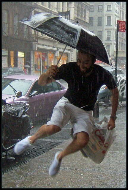 """""""Jumpology"""". """"Jumpin' in the Rain"""". (Photo by Tony Fischer)"""