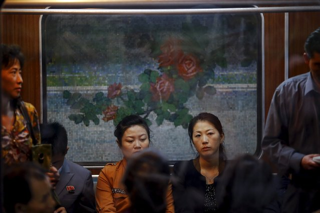 Passengers travel on a train that stopped at a subway station visited by foreign reporters during a government organised tour in Pyongyang, North Korea October 9, 2015. (Photo by Damir Sagolj/Reuters)
