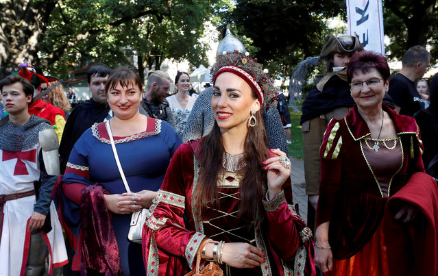 """Participants in colorful costumes parade as they take part in the IX International multicultural festival called """"Count of May 2020"""" at the Vermanes Garden Park in Riga, Latvia, 30 August 2020. The """"Count of May"""" is a unique spring carnival that dates back to a 15th century tradition that nowadays became a family event featuring costumes from various eras and cultural regions with even a competition for the best costumes to elect the """"Count and Countess of May"""". (Photo by Toms Kalnins/EPA/EFE)"""