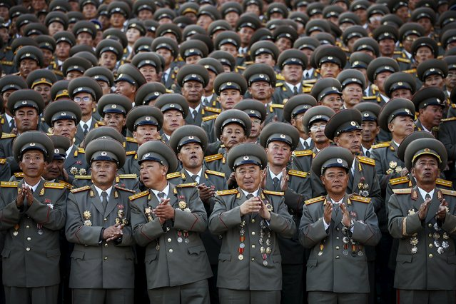 Senior North Korean military officers applaud as troops pass by during the parade celebrating the 70th anniversary of the founding of the ruling Workers' Party of Korea, in Pyongyang October 10, 2015. (Photo by Damir Sagolj/Reuters)