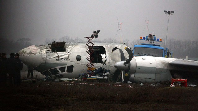 Ukrainian AN-24 plane is seen after crash outside an airport  in the eastern Ukrainian city of Donetsk, Thursday, February 14, 2013. The plane carrying soccer fans headed for a match between Ukraine's Shakhtar and Borussia Dortmund, skidded past the landing strip and overturned, killing five people. The plane was carrying 44 people from the Black Sea port of Odessa. (Photo by Irina Gorbaseva/Associated Press)