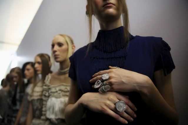 Models line up backstage before the PatBo Winter 2016 RTW collection during Sao Paulo Fashion Week October 20, 2015. (Photo by Nacho Doce/Reuters)