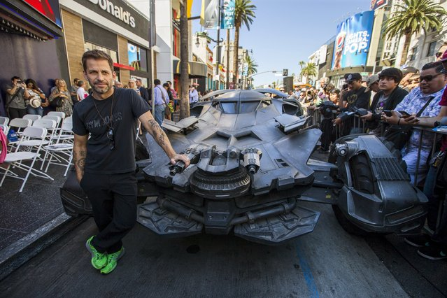"Director Zack Snyder poses by a Batmobile used in the movie ""Batman v Superman: Dawn of Justice"" before posthumously unveiling the star of Batman creator Bob Kane on the Hollywood Walk of Fame in Los Angeles, California October 21, 2015. (Photo by Mario Anzuoni/Reuters)"