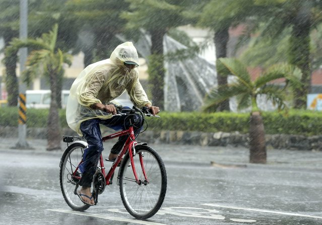 A man braves to heavy rains as typhoon Megi hits Hualien county, eastern Taiwan, 27 September 2016. Typhoon Megi hit Taiwan with heavy winds, causing coastal high waves and flooding rains, according to media reports. (Photo by Ritchie B. Tongo/EPA)