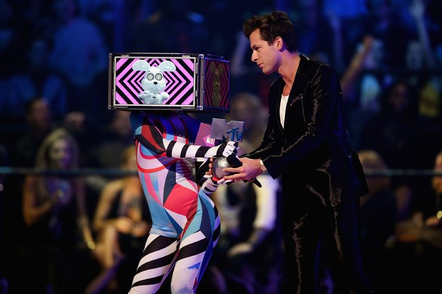 Mark Ronson presents Ed Sheeran the award for Best Live Act on stage during the MTV EMA's 2015 at the Mediolanum Forum on October 25, 2015 in Milan, Italy. (Photo by Brian Rasic/Getty Images for MTV)