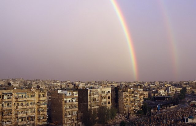 A double rainbow is seen over damaged buildings in Aleppo November 21, 2014. (Photo by Mahmoud Hebbo/Reuters)