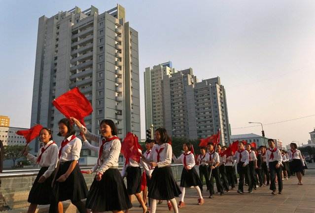 North Korean students sing a patriotic song on a street in Pyongyang, North Korea, Monday, September 24, 2012. (Photo by Vincent Yu/AP Photo)