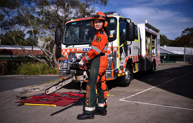 New South Wales state emergency services (SES) volunteer Michelle Whye posing in uniform in front of an emergency vehicle at their headquarters on February 23, 2018 in Sydney, Australia. (Photo by Peter Parks/AFP Photo)