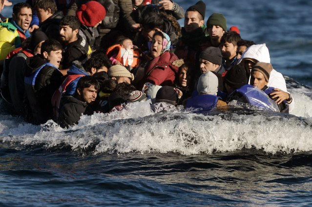 Refugees and migrants arrive on the Greek Lesbos island after crossing the Aegean Sea from Turkey on November 2, 2015. More than 218,000 migrants and refugees crossed the Mediterranean to Europe in October – a monthly record and more than during the whole of 2014, the United Nations said Monday. (Photo by Aris Messinis/AFP Photo)