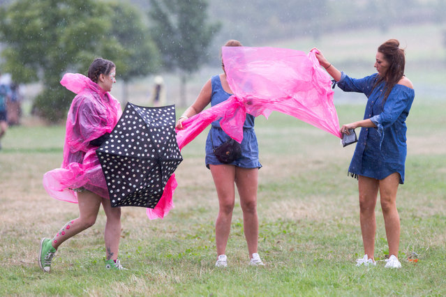 Music fans arriving at Hylands Park in Chelmsford, Essex, on Saturday morning August 20th, 2016 in a mixture of sunshine and heavy showers for this years V Festival. (Photo by Geoff Robinson)