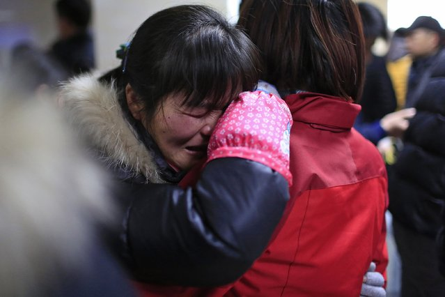 People cry at a hospital after a stampede occurred during a New Year's celebration on the Bund, central Shanghai January 1, 2015. The stampede killed at least 35 people during New Year's Eve celebrations in Shanghai, authorities said, possibly caused by people rushing to pick up fake money thrown from a building overlooking the city's famous Bund waterfront district. (Photo by Aly Song/Reuters)