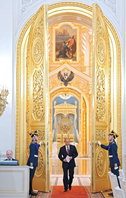 Russian President Vladimir Putin enters a hall to attend a State Council meeting in the Kremlin in Moscow, Friday, May 31, 2013. (Photo by Mikhail Klimentyev/AP Photo/RIA-Novosti/Presidential Press Service)