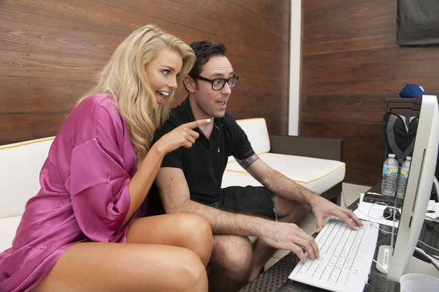 Miss Australia 2014 Tegan Martin sits down with Miss Universe Chief Photo Editor Francis L. Szelwach to review her photos after posing in swimwear at the 63rd annual Miss Universe pageant in Miami, Florida, in this January 5, 2015 handout photo provided by the Miss Universe Organization. (Photo by Reuters/Miss Universe Organization)