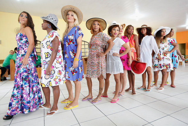 Inmate contestants pose at the annual beauty pageant at the Talavera Bruce women's prison on November 24, 2015 in Rio de Janeiro, Brazil. The pageant aims to humanize and boost the self-esteem of female inmates who receive makeup and hair styling from volunteers. According to the Ministry of Justice, the number of imprisoned females in the country rose 567 percent from 2000 to 2014. (Photo by Mario Tama/Getty Images)