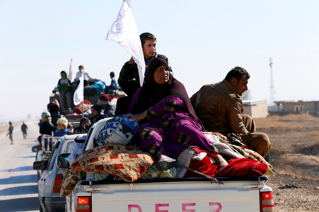 Iraqi displaced family holds white flag as they are fileeing  during a battle with Islamic State militants in Kokjali village near Mosul, Iraq November 03, 2016. (Photo by Ahmed Jadallah/Reuters)