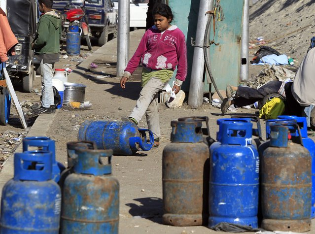 A girl waits to buy gas cylinders at a distribution point in Cairo January 19, 2015. (Photo by Mohamed Abd El Ghany/Reuters)