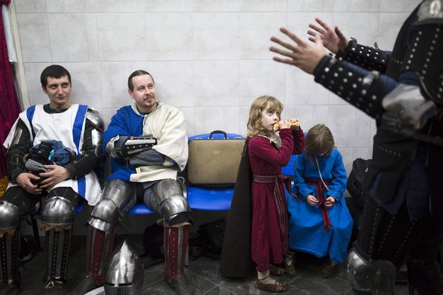 """Israeli competitors are seen at the dressing room during the """"World Medieval Fighting Championship – the Israeli Challenge"""" in Rishon Letzion near Tel Aviv on January 22, 2015. (Photo by Amir Cohen/Reuters)"""