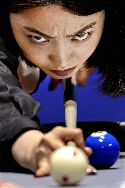 Cha Youram of Korea plays a shot against Chitchomnart Siraphat of Thailand during the Billiards, Women's 10 Ball Single Round of 32 Match at Songdo Convensia on day four of the 4th Asian Indoor & Martial Arts Games  in Incheon, South Korea, on July 2, 2013. (Photo by Chris McGrath/Getty Images)