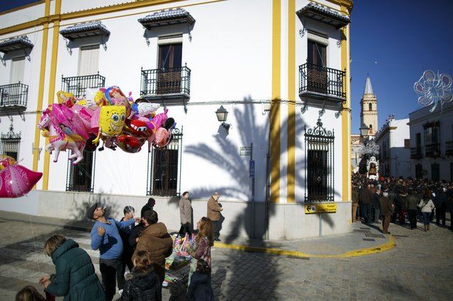 A man sells balloons during the annual San Antonio Abad (Saint Anton Abbott) festival in Trigueros, southwest Spain January 25, 2015. (Photo by Marcelo del Pozo/Reuters)