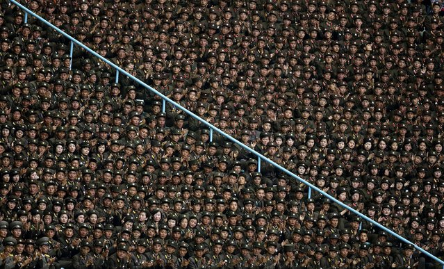 North Korean soldiers clap as they listen to President of the Presidium of the Supreme People's Assembly of North Korea Kim Yong-nam deliver a speech at the stadium. (Photo by Jason Lee/Reuters)