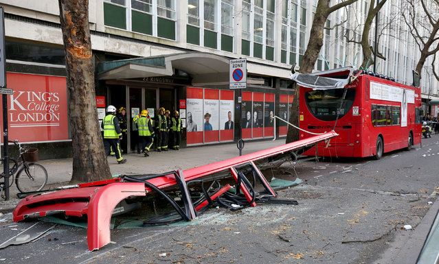 Emergency services arrive at the scene after five people were treated for minor injuries when a London bus had its roof ripped off in Kingsway, London, Monday, February 2, 2015. The roof of a 91 bus appeared to have been ripped off by overhanging trees. (Photo by Philip Toscano/AP Photo/PA Wire)