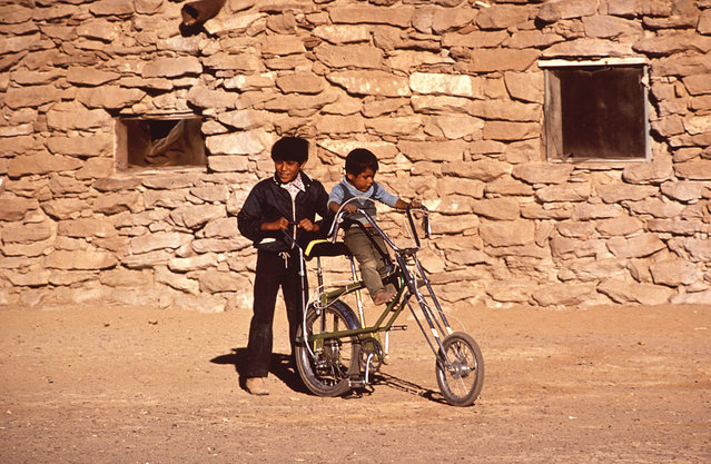 Boys play on a bicycle on the Hopi Reservation in Arizona, in 1972. (Photo by Terry Eiler/National Archives and Records Administration via The Atlantic)