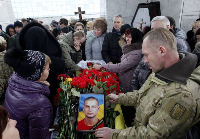 """People attend a funeral ceremony for Vadym Zherebylo, a member of self-defence battalion """"Aydar"""", who was killed in the fighting in Luhansk region in eastern Ukraine, at Independence Square in central Kiev February 2, 2015. (Photo by Valentyn Ogirenko/Reuters)"""