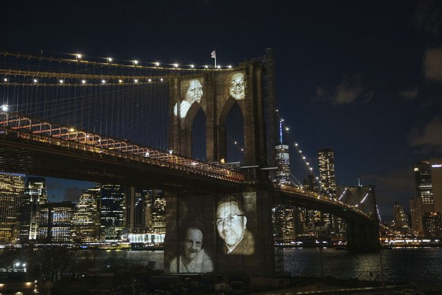 New Yorkers who died during the coronavirus pandemic are projected onto the Brooklyn Bridge during a commemoration ceremony Sunday, March 14, 2021, in Brooklyn, NY. (Photo by Kevin Hagen/AP Photo)