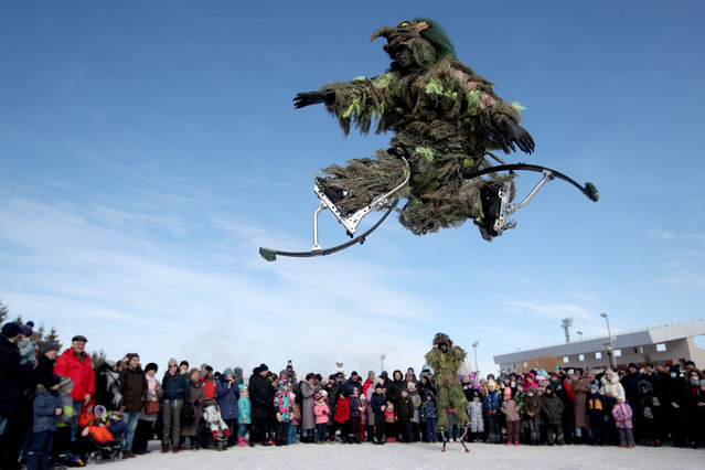 Men on jumping stilts perform during Nowruz celebrations at the Kazan multifunctional equestrian center on March 21, 2021. Nowruz, also known as the Iranian or the Persian New Year, commemorates the first day of spring; it is celebrated by various Turkic and Iranian ethnic groups on the spring equinox (March 21). (Photo by Yegor Aleyev/TASS)