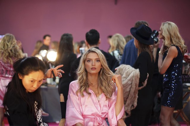 Model Lily Donaldson is being made up before the Victoria's Secret fashion show in Paris, France, Wednesday, November 30, 2016. The pulse-quickening, celebrity-filled catwalk event of the year: the Victoria's Secret fashion show takes place in Paris with performances from Lady Gaga and Bruno Mars. (Photo by Thibault Camus/AP Photo)