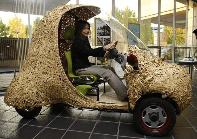 """Bamgoo"", an electric car with a body made out of bamboo, is displayed in Kyoto, western Japan November 14, 2008. The sixty-kilogram single-seater ecologically friendly concept car, which measures 270 centimeters in length, 130 centimeters in width and 165 centimeters in height, is developed by Kyoto University Venture Business Laboratory, featuring bamboo articles in the Kyoto area. The car can run for 50 kilometers on a single charge. (Photo by Issei Kato/Reuters)"