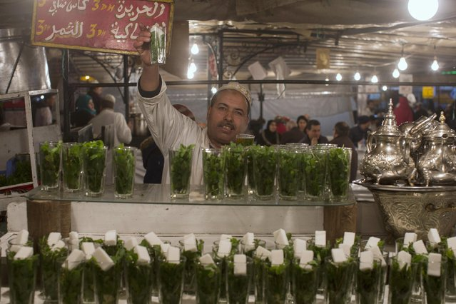 A vendor prepares Moroccan tea at food stands in Djemaa El Fna square in Marrakesh December 8, 2014. (Photo by Youssef Boudlal/Reuters)