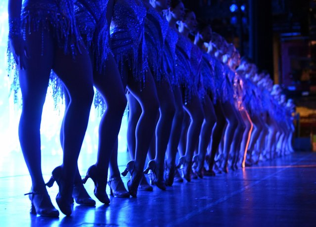 A view from backstage as the Rockettes line up during a song during the 2015 Radio City Christmas Spectacular at Radio City Music Hall in New York City on December 2, 2015. (Photo by Timothy A. Clary/Getty Images)