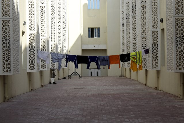 Laundry is seen hung out to dru outside migrant workers' accommodation in Labor City, Qatar, January 13, 2016. (Photo by Naseem Zeitoon/Reuters)
