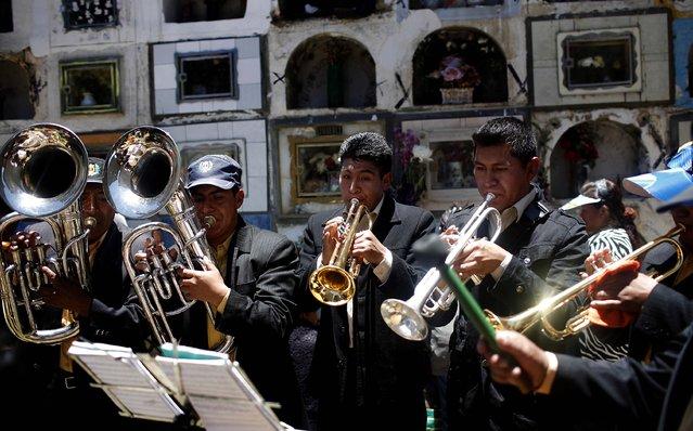 Musicians perform during the Natitas Festival at the Cementerio General in La Paz. (Photo by Juan Karita/Associated Press)