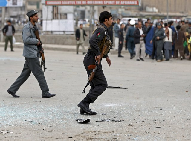Afghan police arrive at the site of a suicide attack in Kabul March 25, 2015. (Photo by Omar Sobhani/Reuters)