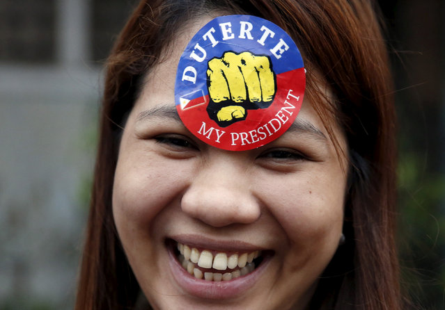 A supporter of President Rodrigo Duterte is pictured during presidential election campaigning in Malabon, Metro Manila in the Philippines April 27, 2016. (Photo by Erik De Castro/Reuters)