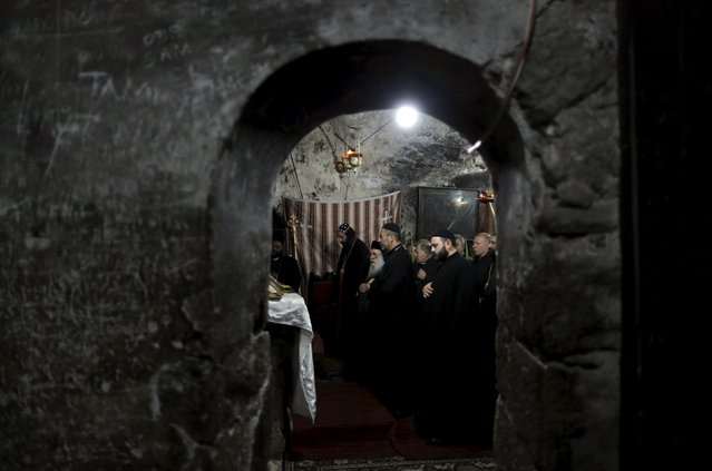 Members of the Coptic Orthodox clergy take part in Palm Sunday mass in the Church of the Holy Sepulchre in Jerusalem's Old City April 5, 2015. (Photo by Ammar Awad/Reuters)