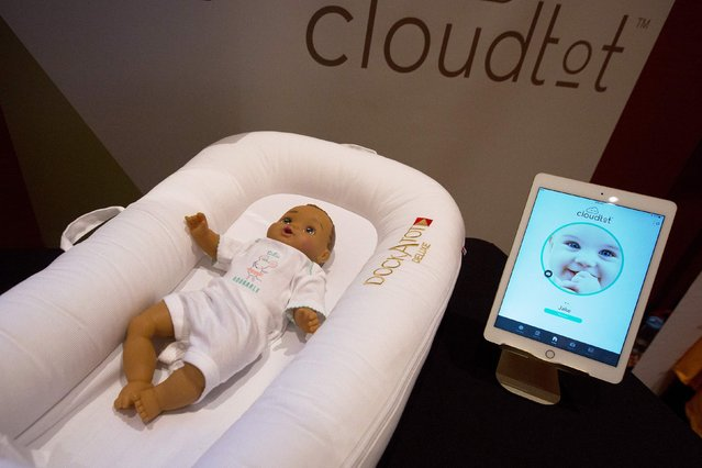 A DockATot Deluxe smart baby bed and app are shown at ShowStoppers during the 2017 Consumer Electronic Show (CES) in Las Vegas, Nevada on January 5, 2017. (Photo by David McNew/AFP Photo)